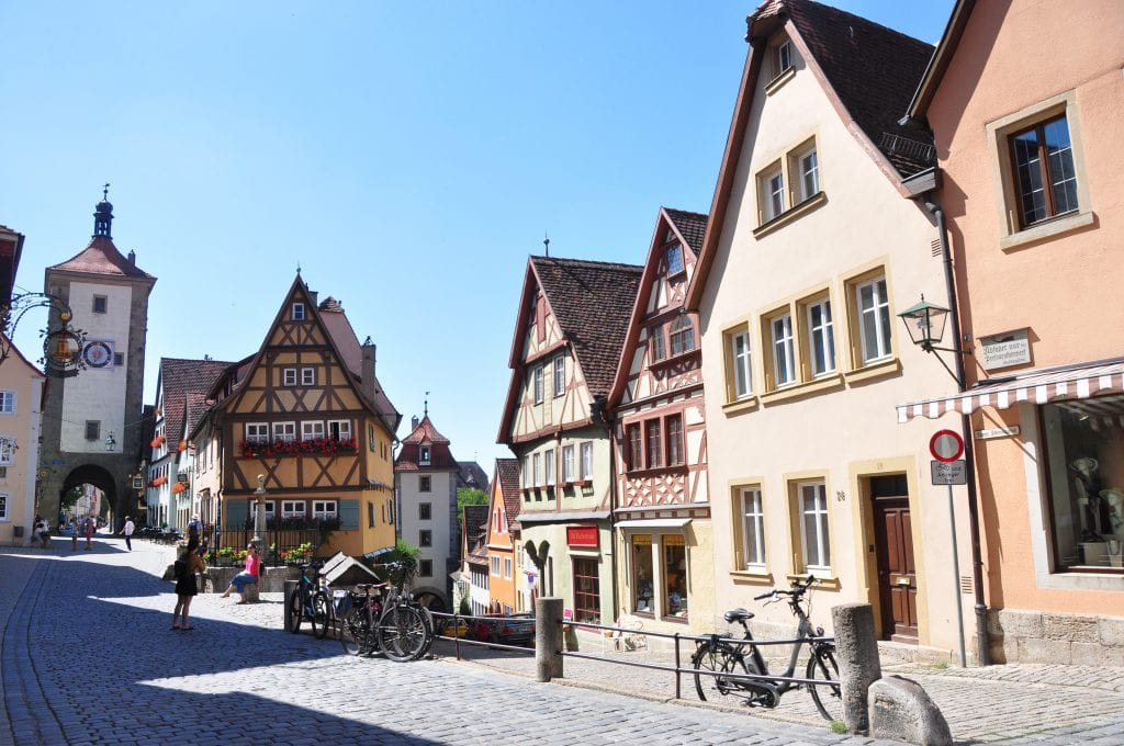 colorful timbered houses ane cobblestone street in walled city of Rothenburg ob der Tauber