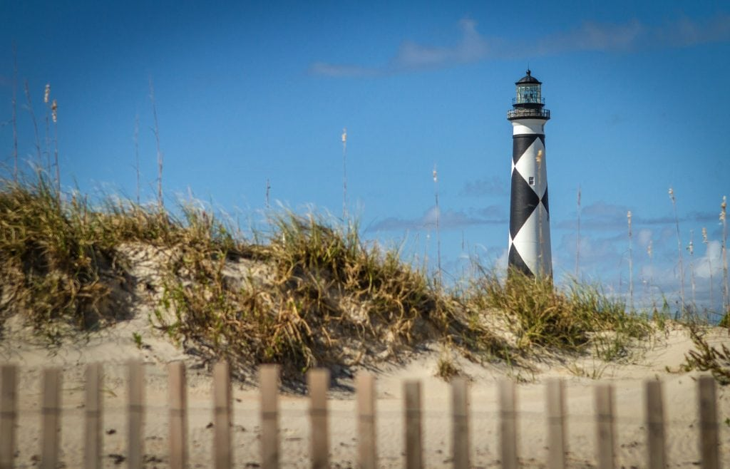 Black and white lighthouse on Cape Lookout Seashore in Outer Banks North Carolina