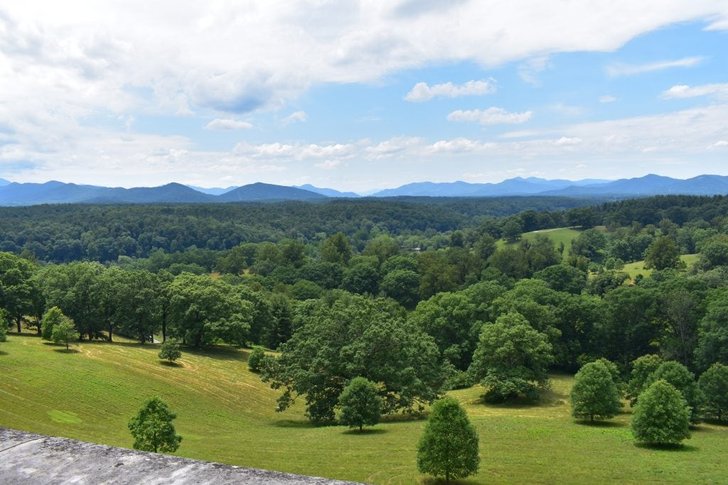 blue mountains and green forest and hills as seen from porch of Biltmore house