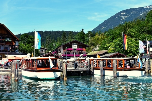 Boat dock with timbered buildings and mountainside