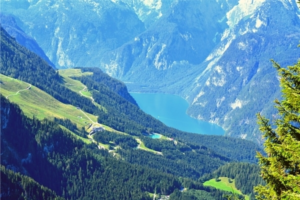 Blue Konigssee lake in green mountain valley