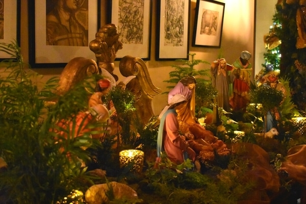 nativity set with green garland and candles