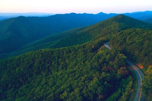 Blue Ridge Parkway winds through the green forests of the Blue Ridge Mountains