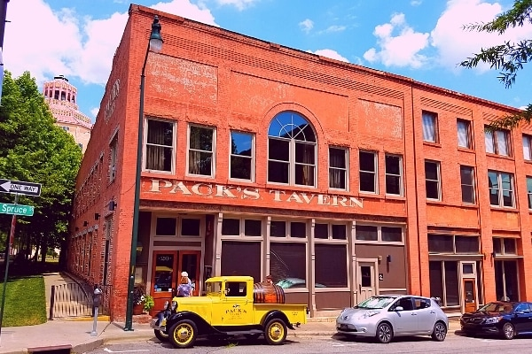 Pack's Tavern original brick building and signature yellow truck parked out front