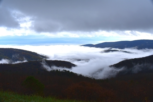 White and Gray clouds fill the mountain valleys of Shenandoah National Park with a sliver of blue sky peeking through.