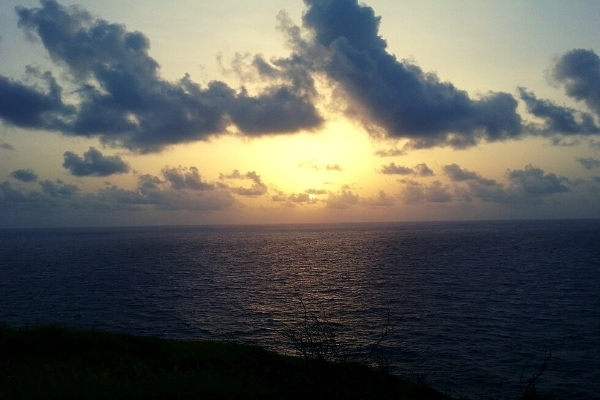 Sunrise over the ocean with some clouds on the eastern most point of St Croix USVI