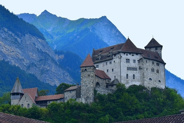 Gutenberg Castle sits on a hill above town but is towered over by the mountains in the background