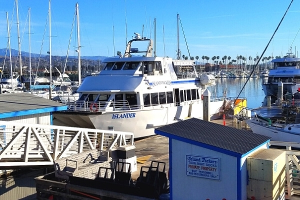 The white and blue Island Packers double deck ferry boat docked in the Ventura marina