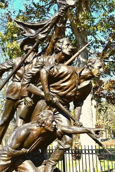 Bronze statue of four weary soldiers forging on through battle at the North Carolina Memorial at Gettysburg National Military Park