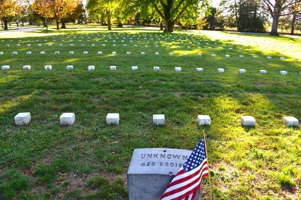Array of small square white headstones marking unknown soldiers at Gettysburg National Cemetery