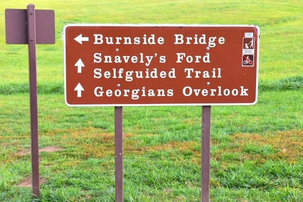 Brown panel sign directing visitors to different locations around Antietam National Battlefield