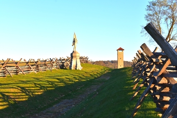 Sunken Road, also known as Bloody Lane, at Antietam Battlefield is lined by wooden fences on both sides and the brown stone observation tower on the end