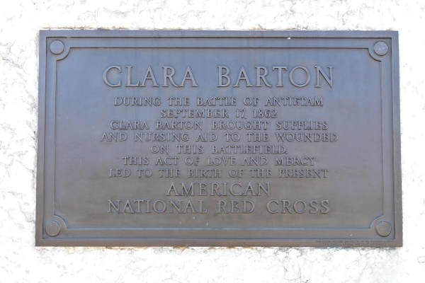 Metal plaque in a white stone memorial commemorating Clara Barton, founder of the American Red Cross