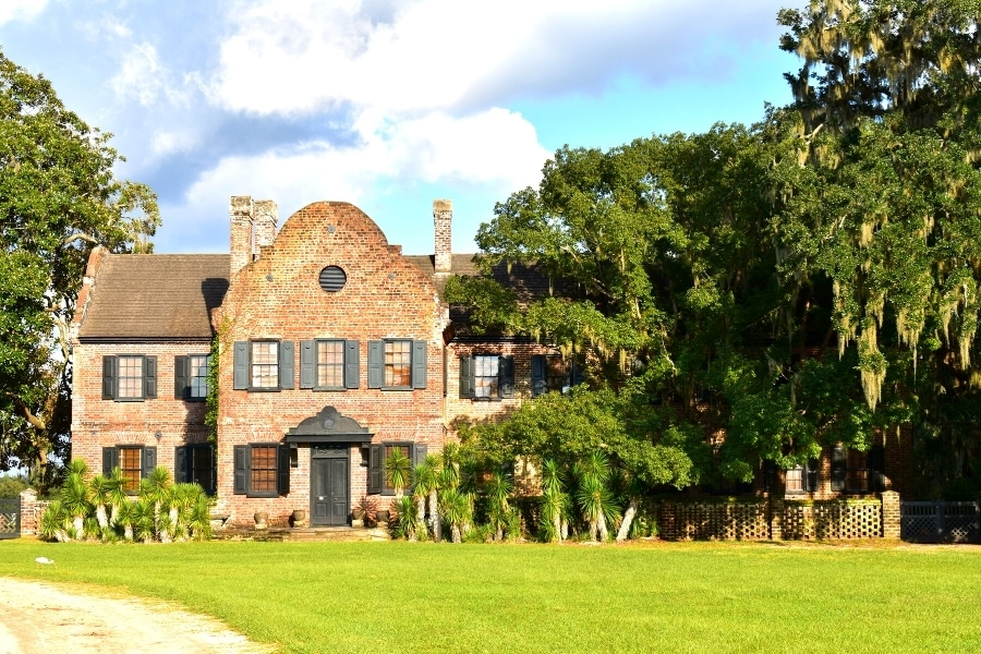 Old brick colonial period home surrounded by oak trees on the Middleton Plantation