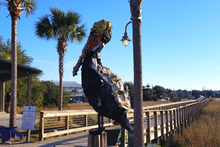 Shem Creek Boardwalk's pelican statue made of plastic found in the ocean
