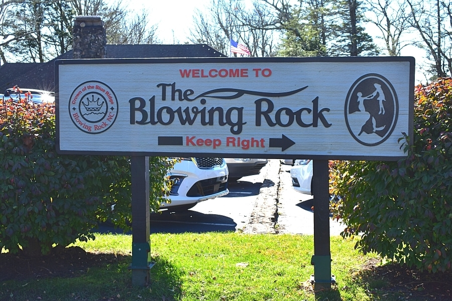 Wooden sign welcoming vehicles to The Blowing Rock site