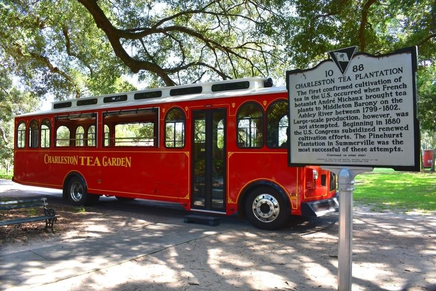 Red Charleston Tea Garden Trolley bus with historical marker